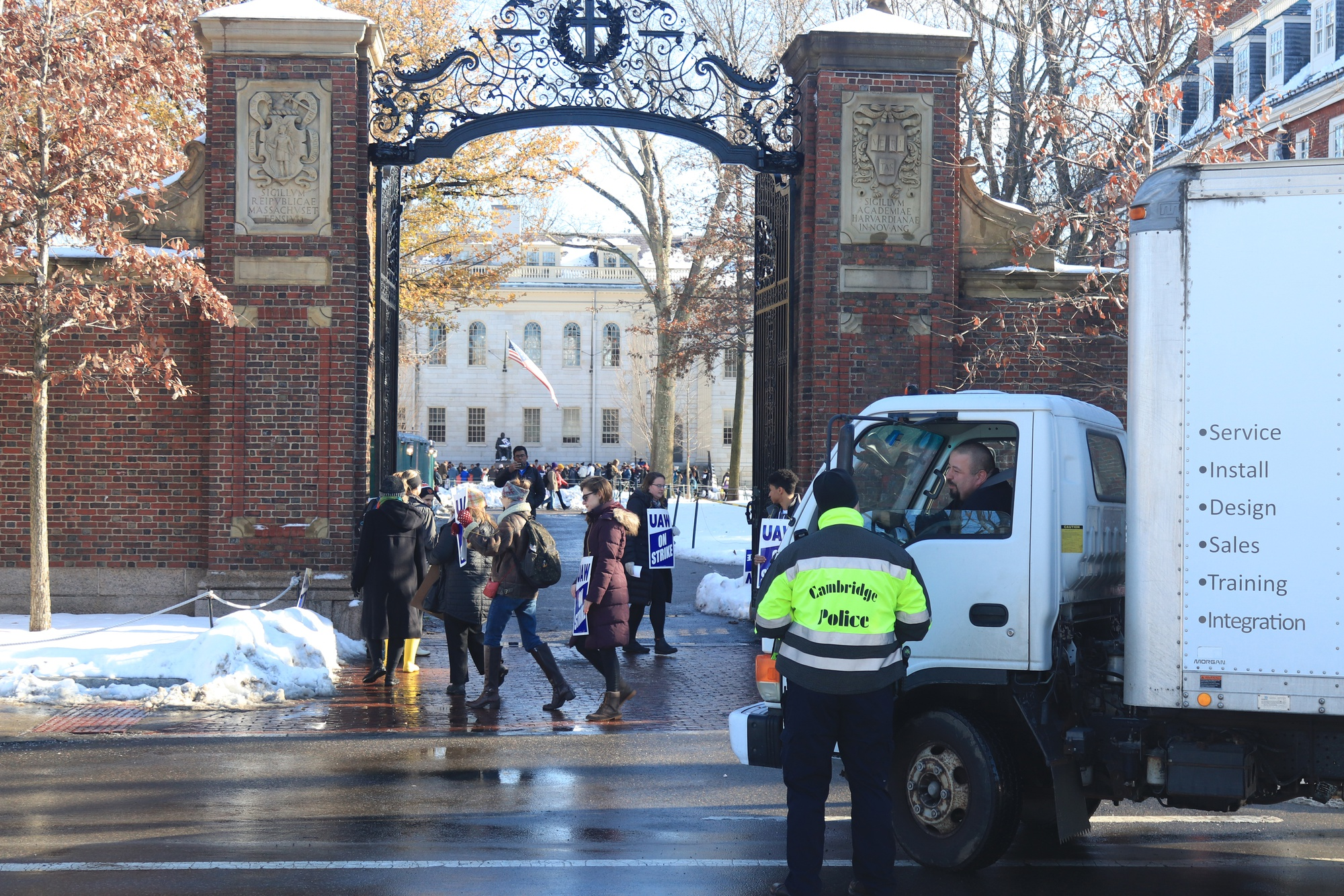 Picketers blocked delivery and mail trucks from entering Johnston Gate of Harvard Yard.