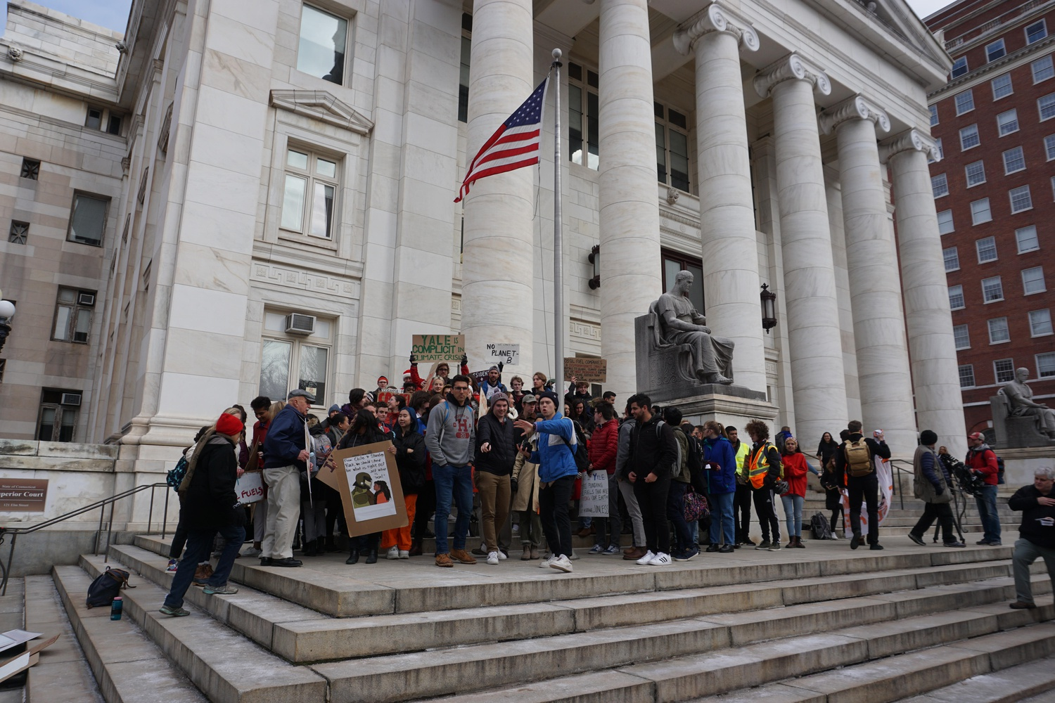 More than 50 Yale and Harvard students gathered outside of New Haven Superior Court Friday morning after several students appeared for a hearing after their November arrest for demonstrating at the Harvard-Yale football game.