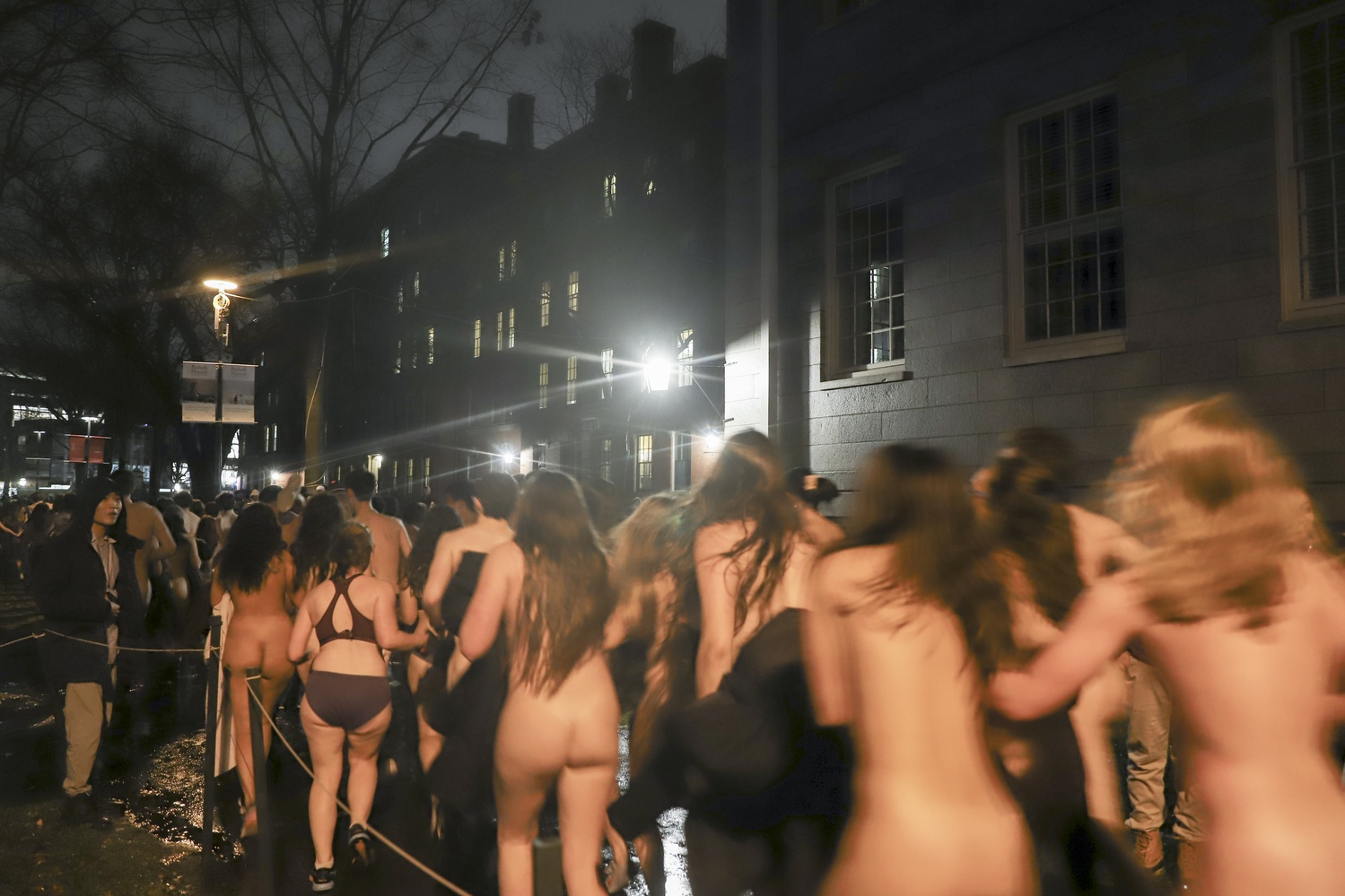 On rainy Monday night, a large number of students gathered in the Harvard Yard for Primal Scream, a biannual tradition where students run naked around the Yard before finals begin.