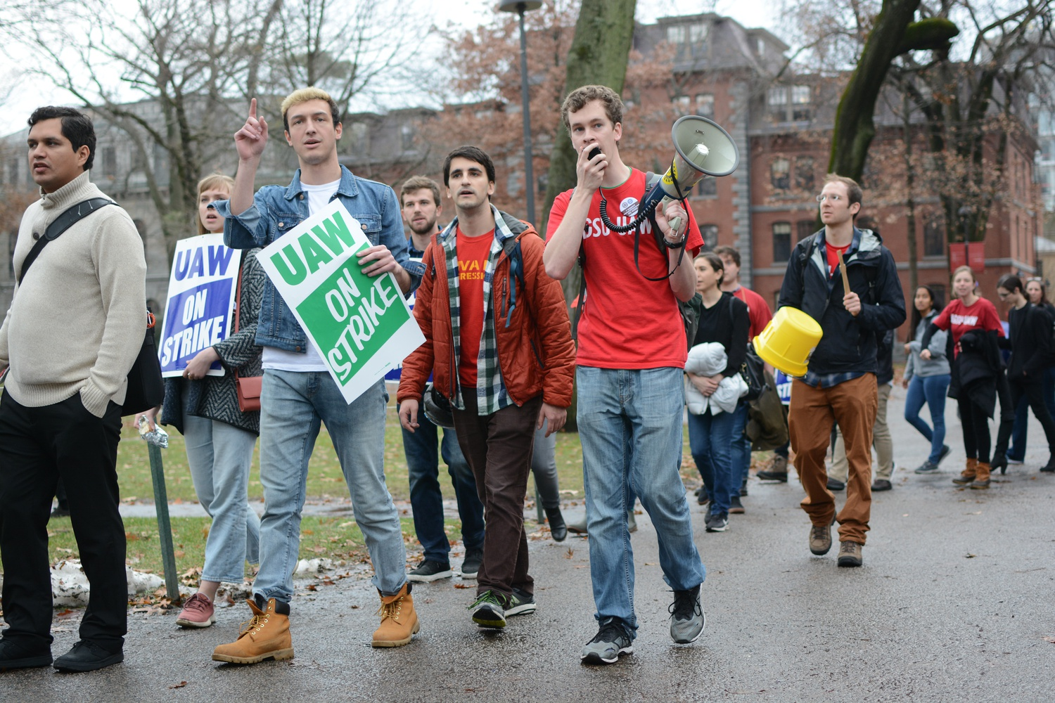 Union members and supporters picket outside Mass. Hall Tuesday afternoon on the sixth day of the HGSU-UAW strike.