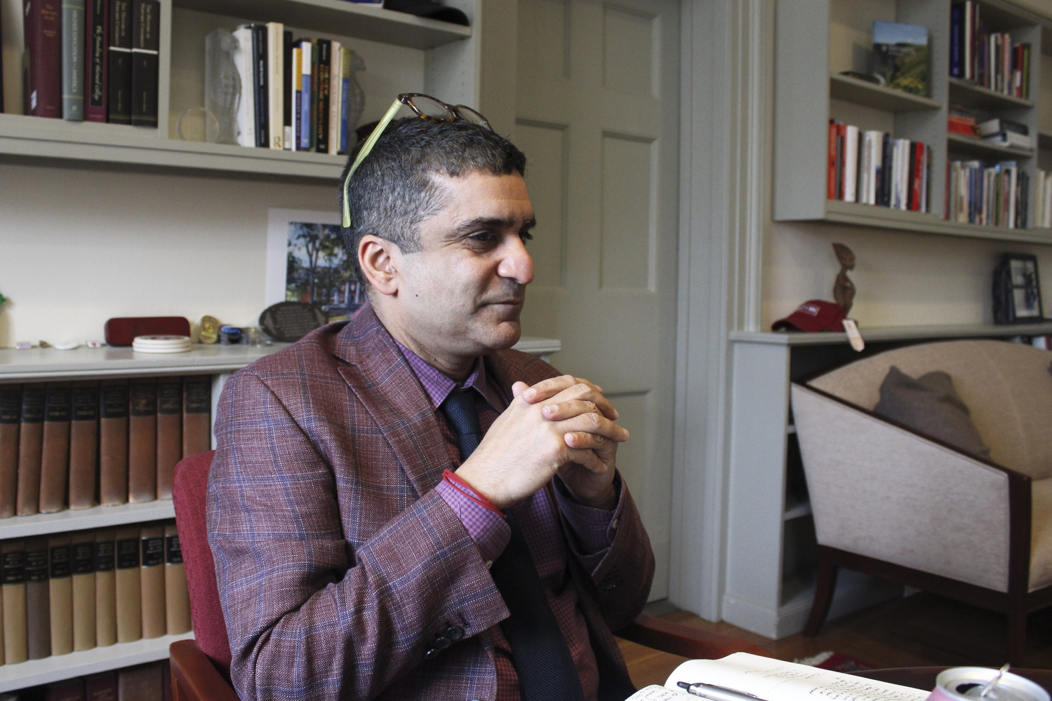 Dean of the College Rakesh Khurana sits in his office in University Hall during an interview on Tuesday.