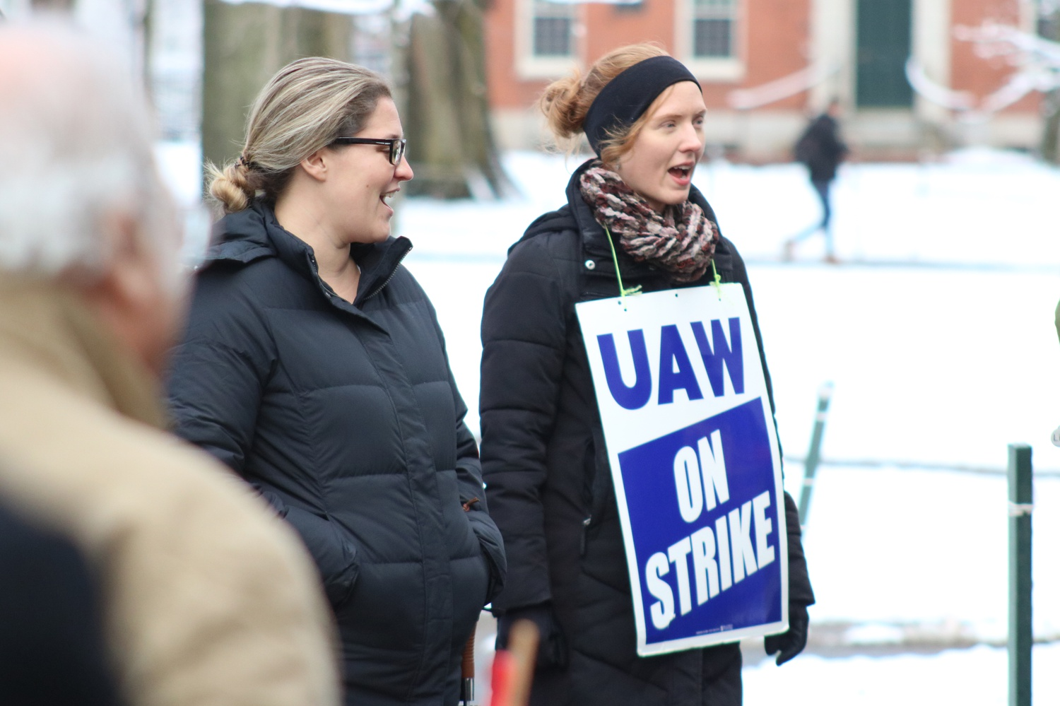 Members of the Harvard Graduate Student Union-United Automobile Workers stand in front of University Hall. The union has reached their seventh day of picketing with negotiations still ongoing.