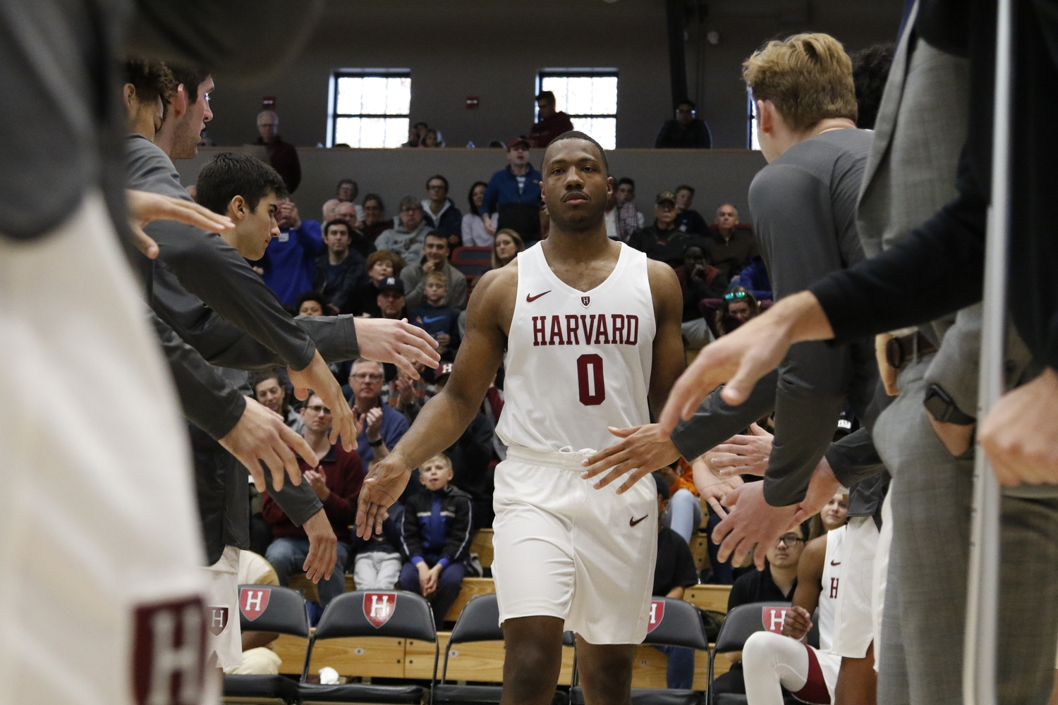 Senior Chris Lewis is introduced before a home victory against Maine.