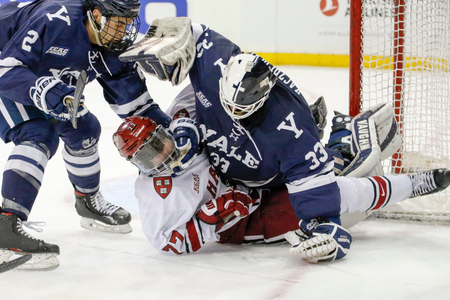 Yale net-minder Corbin Kaczperski let his frustration get the best of him when he piled on — and threw punches at — Harvard freshman Henry Thrun late in the contest.