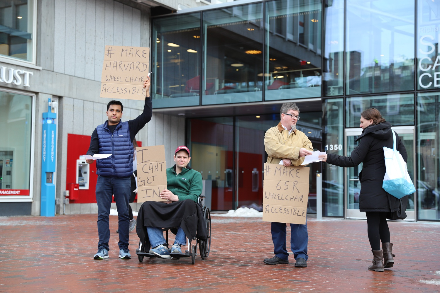 On Friday afternoon, Raman Solanki, Robert A. Weckesser, and Christopher J. McCarthy protested the inaccessible entrance to an HUIT building at 65R Mt. Auburn St.