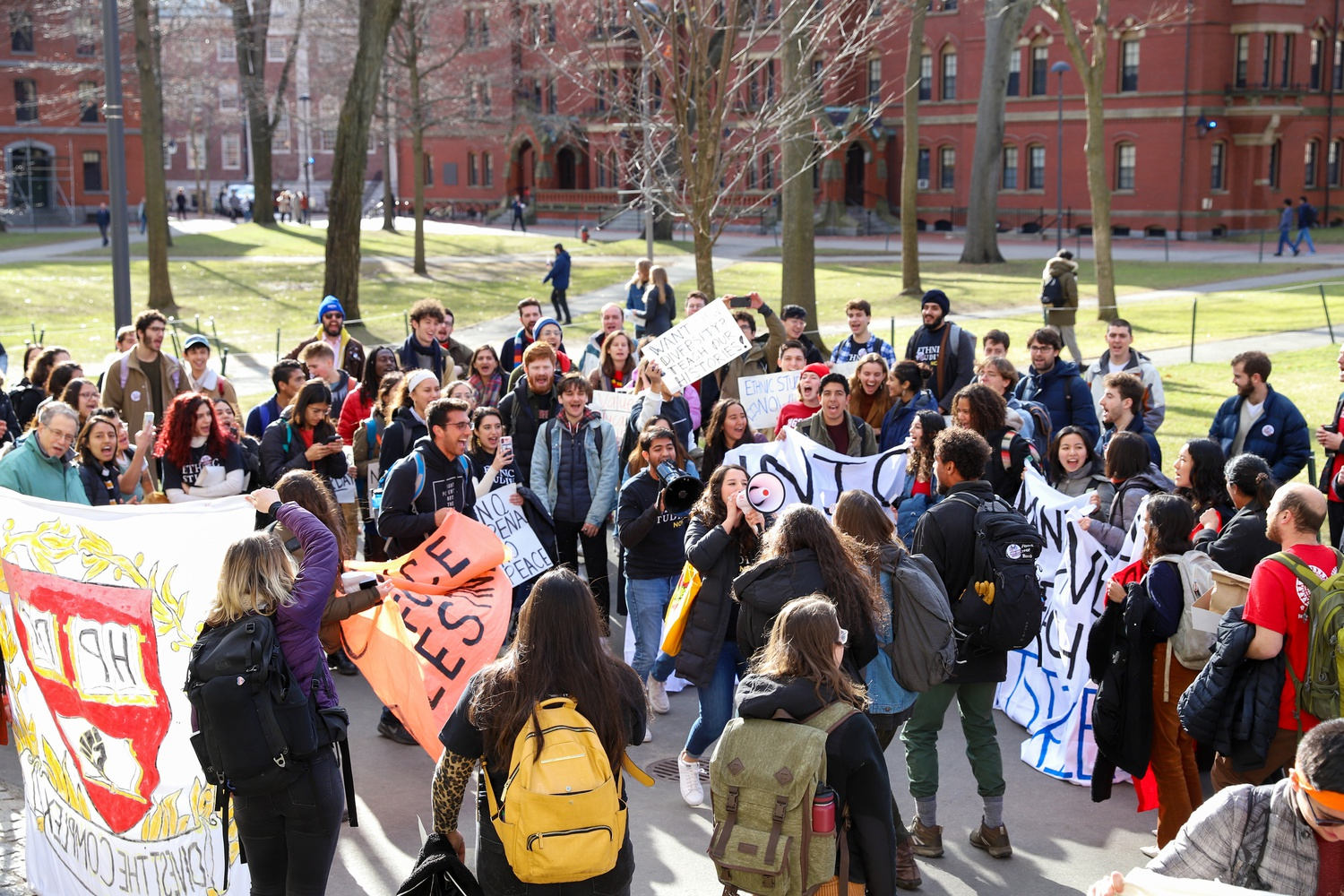 After hosting a demonstration in the Science Center Lobby, various student groups marched toward the John Harvard Statue to commence the Reorientation Rally.