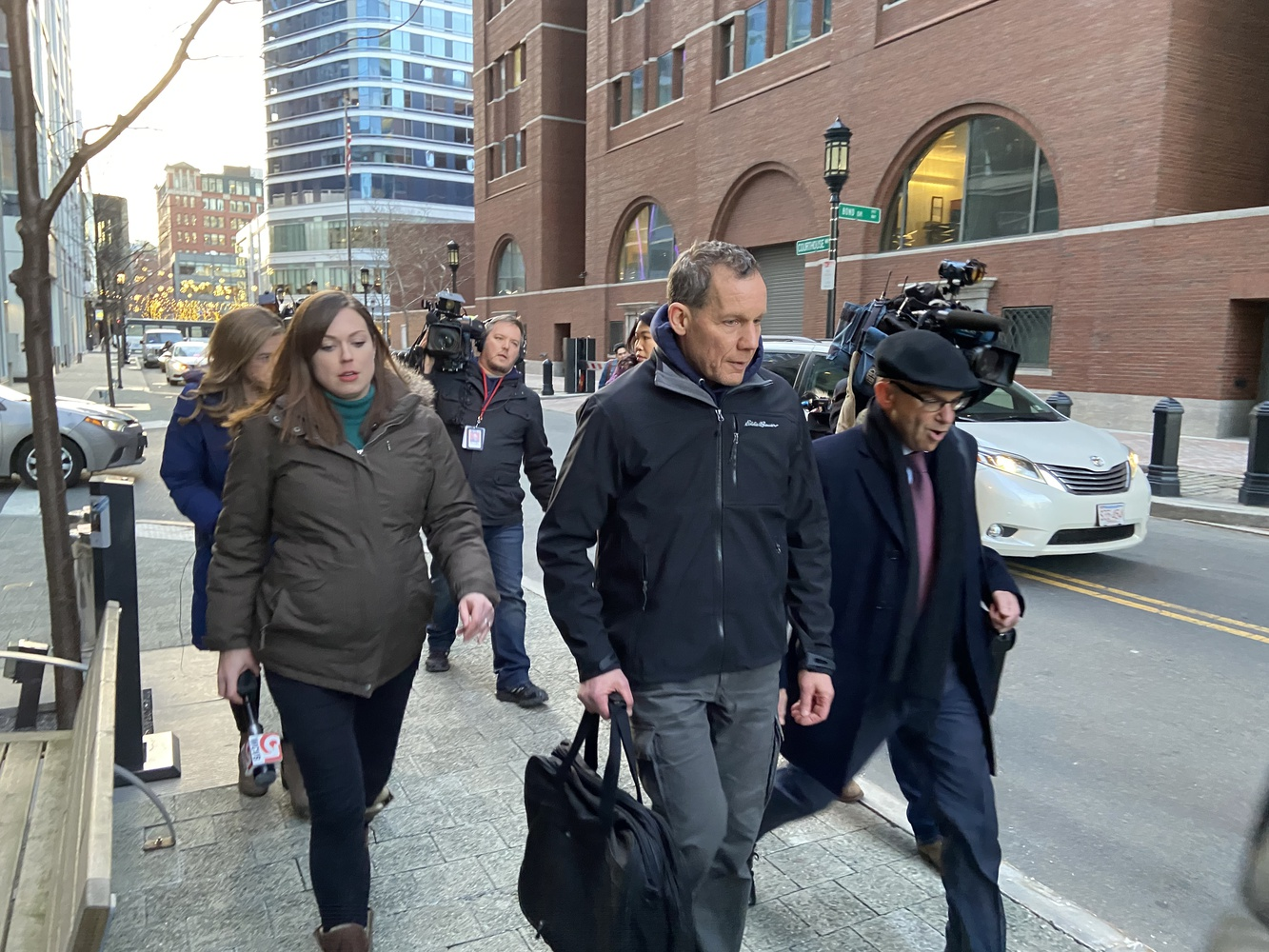 Chemistry professor Charles M. Lieber (center) leaves the John Joseph Moakley Courthouse in Boston after a bail hearing.