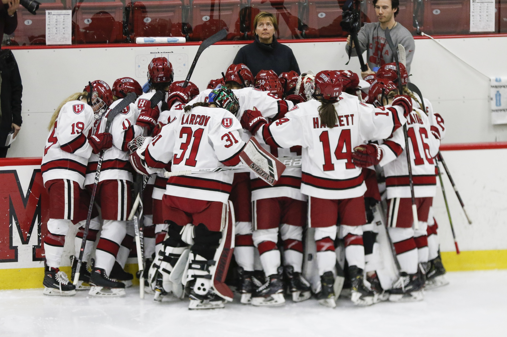 Harvard huddles during its 2019 Beanpot finals appearance against Boston University. This year, however, the Crimson will not have the chance to avenge its overtime loss to the Terriers, falling in the 2020 semifinals.