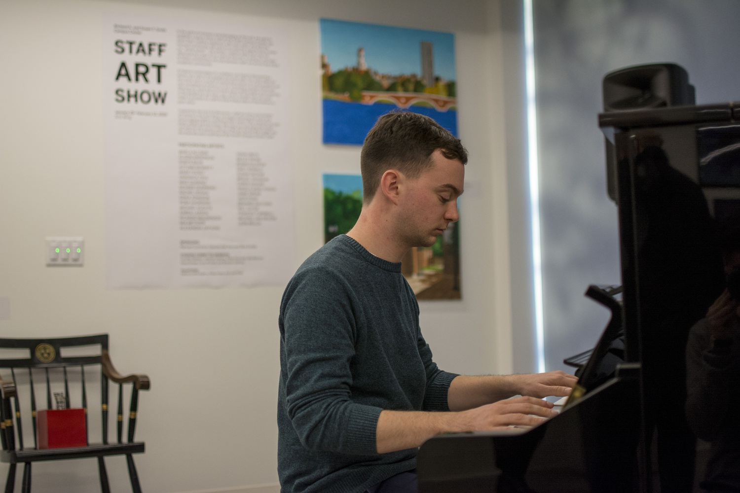 Jack Staid, who works at HUHS, was one of the participating artists at the Staff Art Show Wednesday at the Smith Campus Center. He has been playing the piano for 20 years and played three songs during the exhibition.