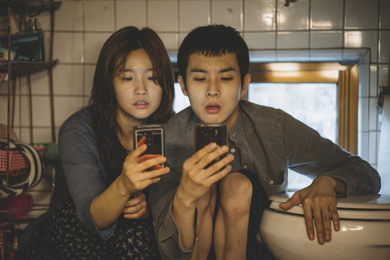 "So-dam Park (left) stars as Ki-jung Kim and Woo-sik Choi (right) stars as Ki-woo Park in ""Parasite"" (2019), directed by Bong Joon-ho."