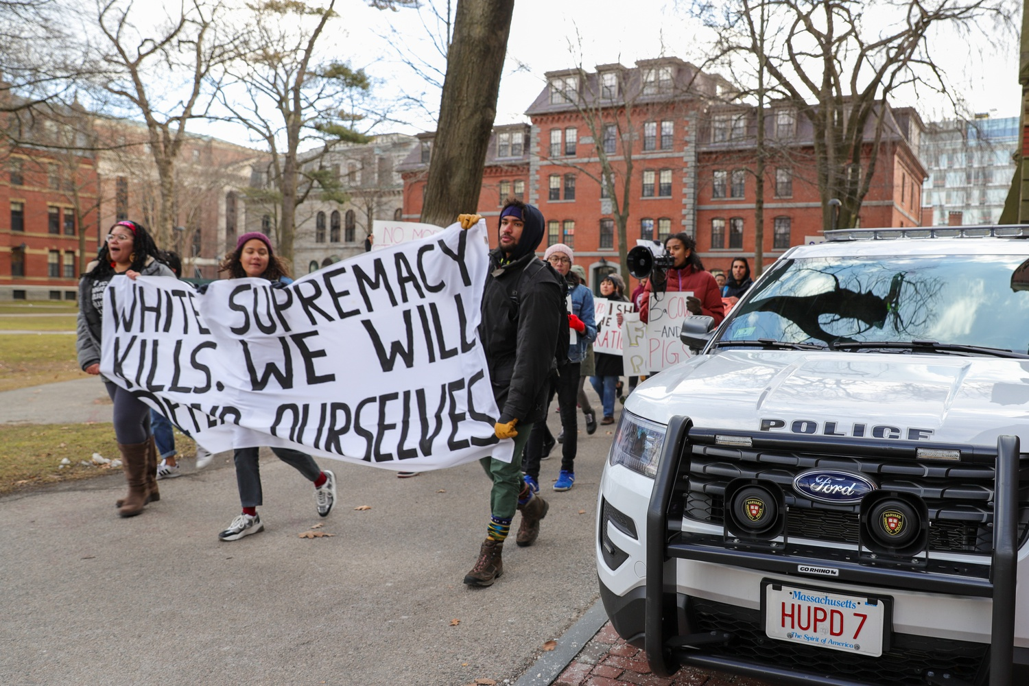 At a February 2020 protest, demonstrators called for the abolition of the Harvard University Police Department.