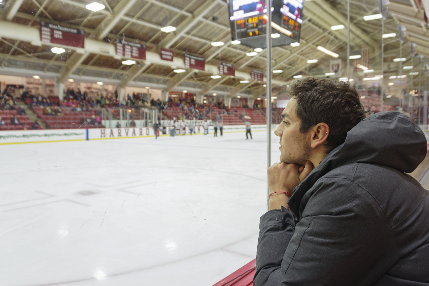 Staff writer Alec P. Kahn stares into the transparent glass that encases the rink and looks into his reflection.