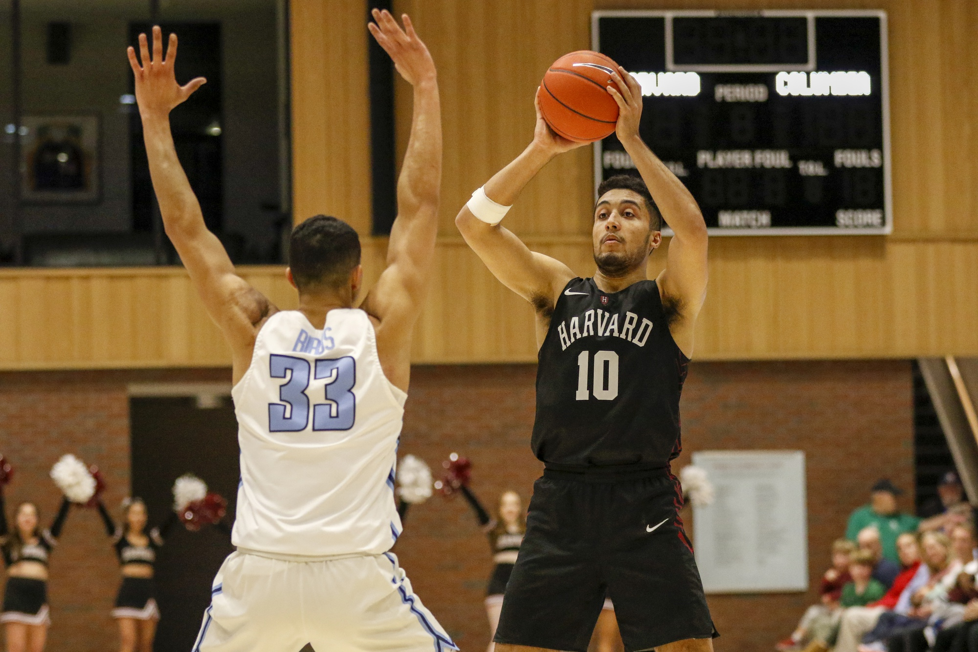 Noah Kirkwood looks to make a play with Columbia's Tai Bibbs guarding him. Kirkwood came up huge in overtime, when he scored 10 of his team-high 22 points in Harvard's win.