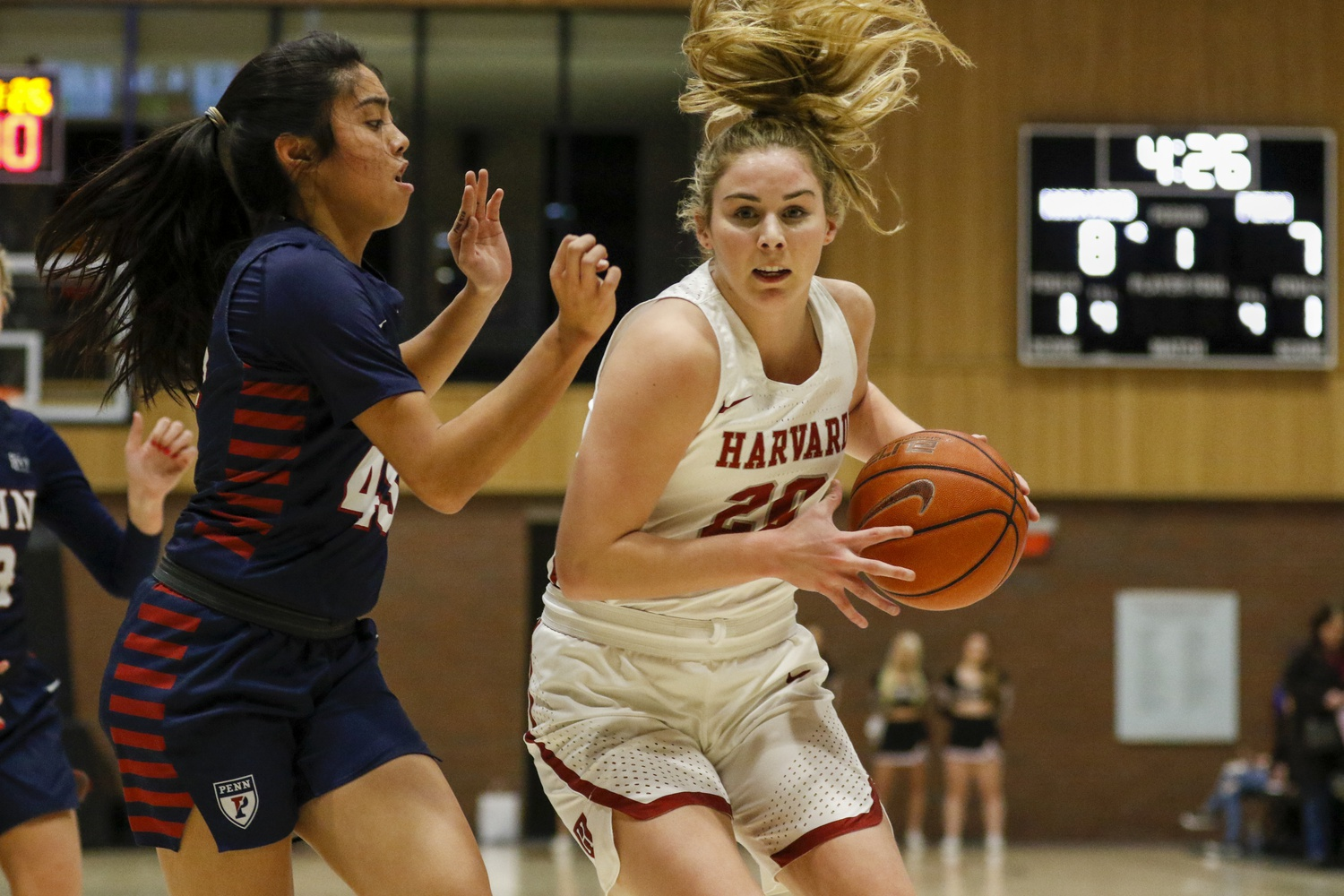 Lola Mullaney looks to drive in Harvard's big win over Penn earlier this season. She closed the season strong, scoring 33 points in the Crimson's final two games.