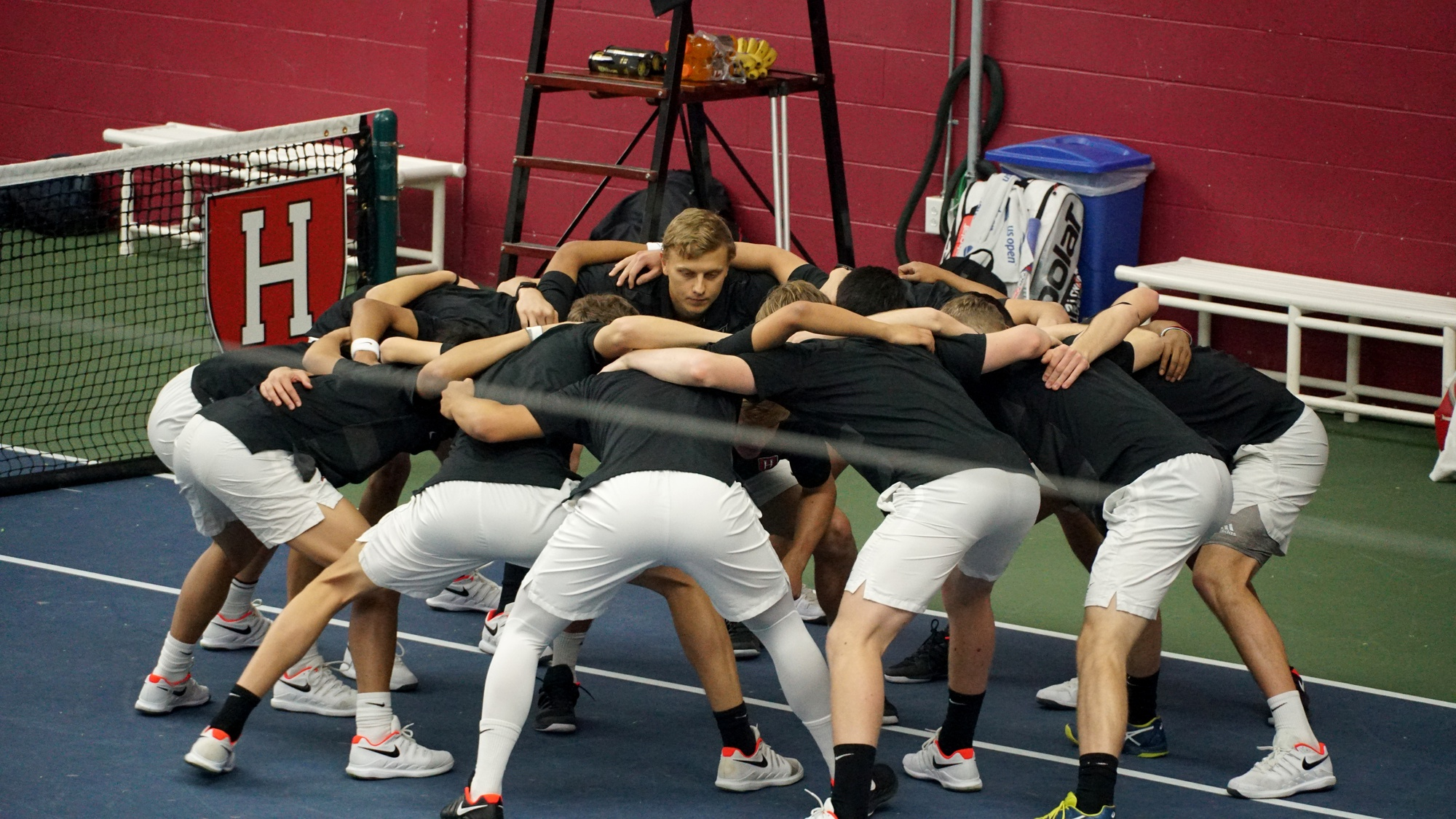The Crimson men get together for a pre-match huddle before the highly anticipated ECAC Tournament.