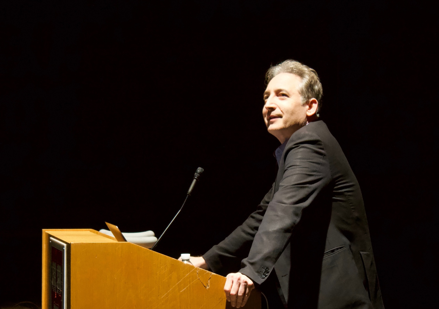 """Brian R. Greene '84 describes the history of time at a presentation about his new book — """"Until the End of Time"""" — in the Science Center on Wednesday."""
