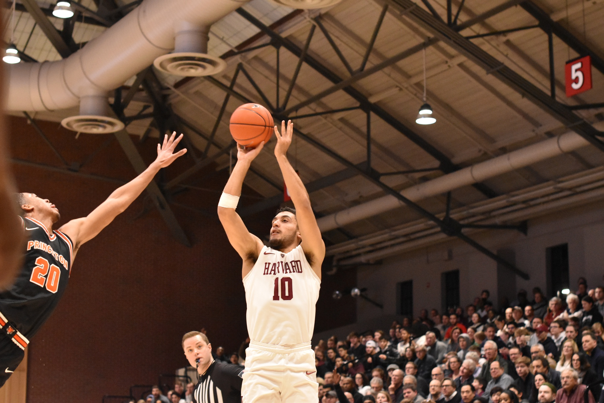 Noah Kirkwood rises for a shot against Princeton. The sophomore guard has become Harvard's go-to scorer in the absence of Bryce Aiken, averaging over 15 points per game in the last nine.