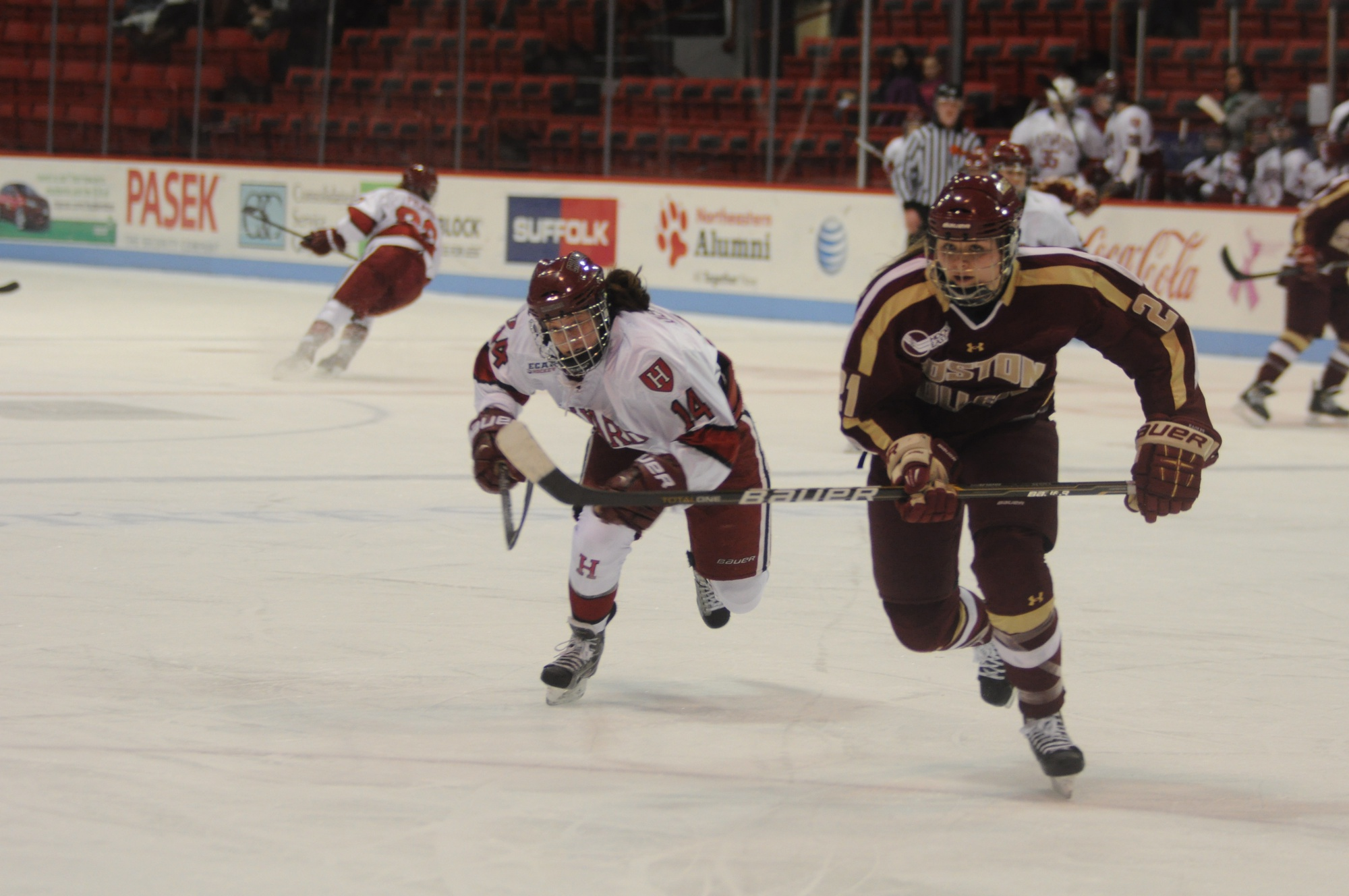 Jillian Dempsey '13 hustles back into the play against Boston College in 2013.