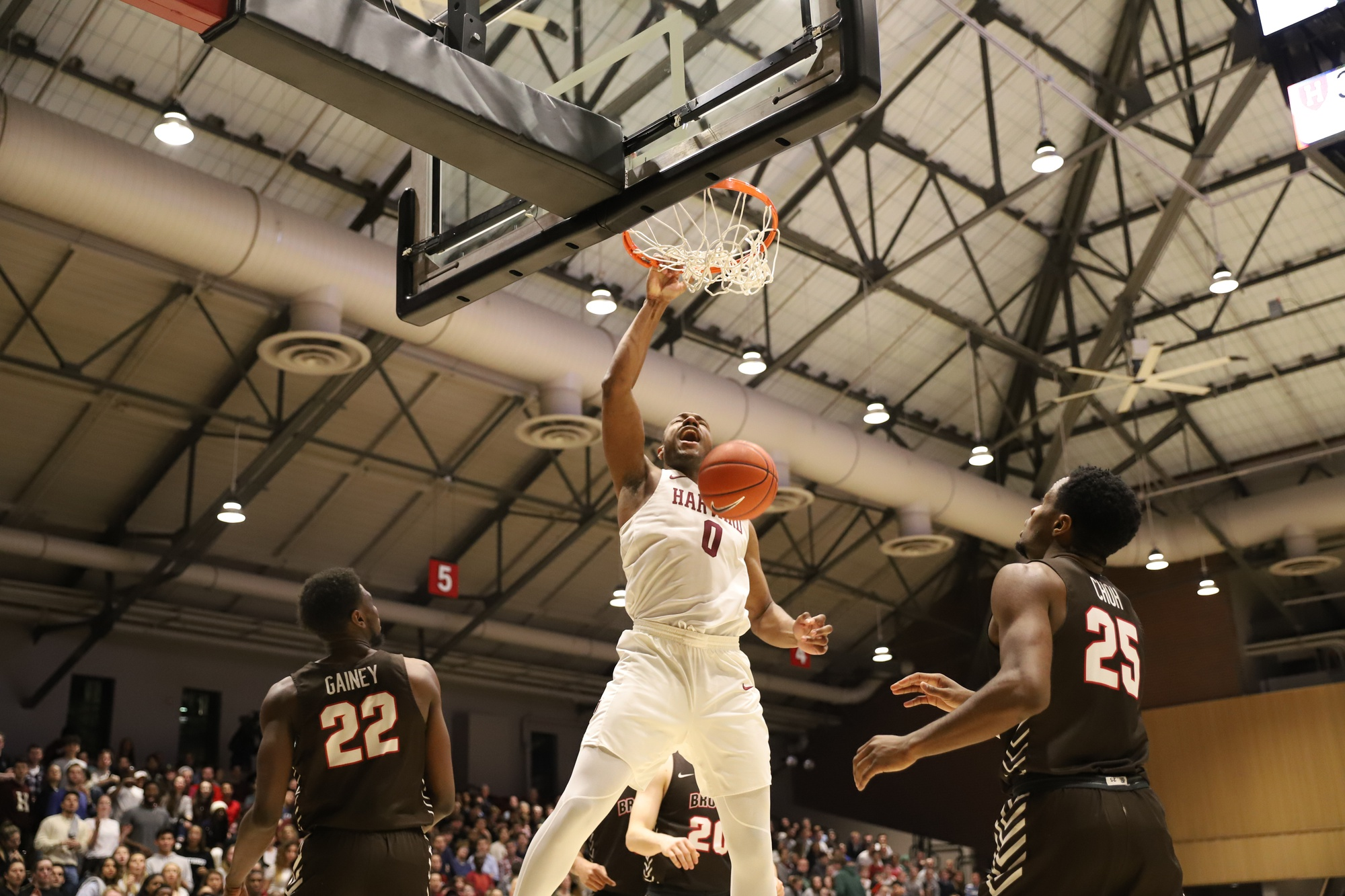 Chris Lewis dunks for two of his 13 points. He was one of seven Harvard seniors honored on senior night at Lavietes Pavilion, but his efficient performance was not enough to extend the Crimson's six game winning streak.