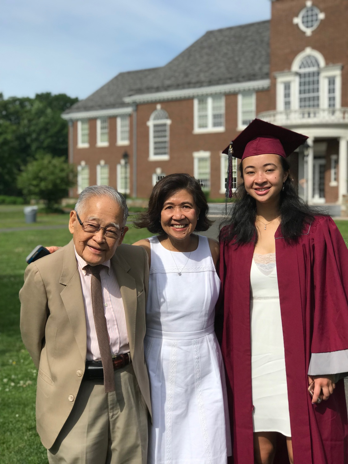 Staff writer Maliya Ellis with her mother and grandfather at her high school graduation
