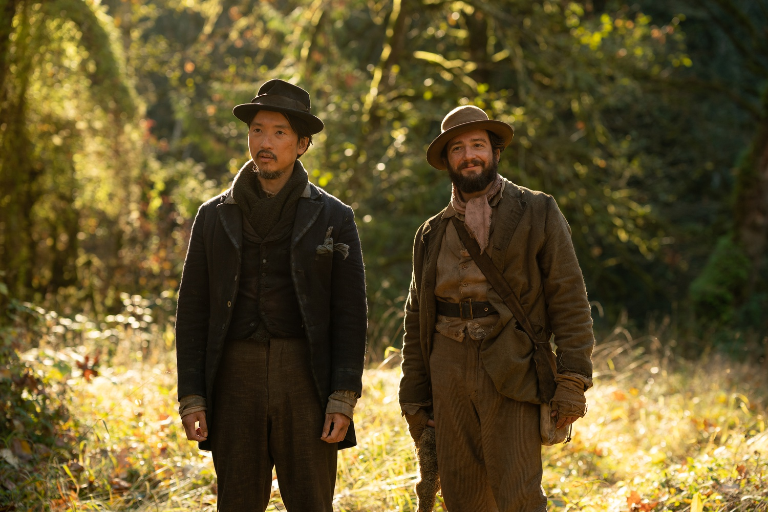 """Orion Lee (left) stars as King Lu and John Magaro (right) stars as Cookie in """"First Cow"""" (2020), directed by Kelly Reichardt."""