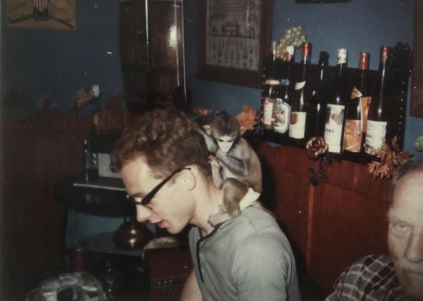 Kurt W. Fischer pictured with his monkey, Frodi.