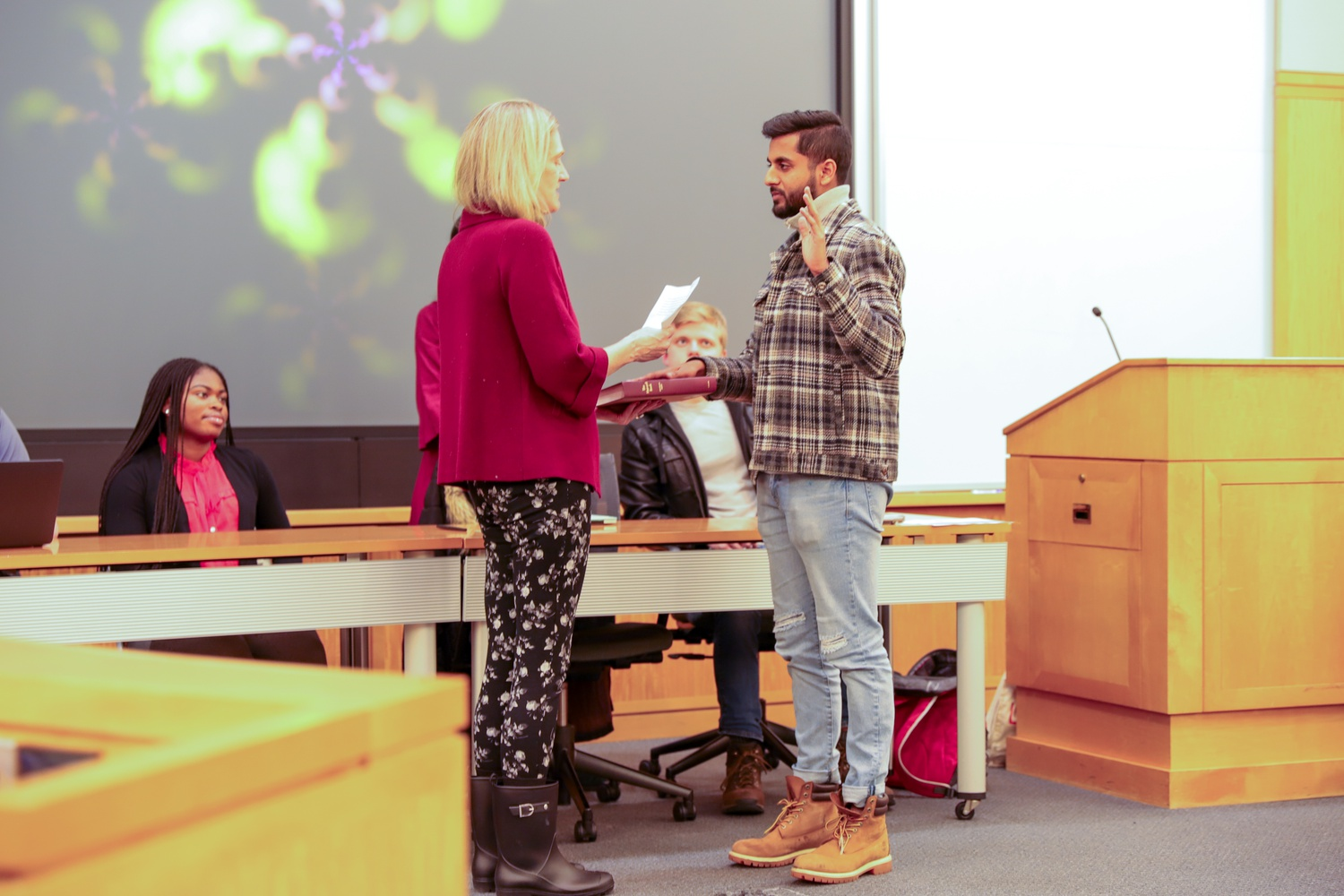 At a ceremony in December 2019, the incoming Undergraduate Council president, James A. Mathew '21, was formally inducted at the inauguration ceremony by Dean of Students Katherine G. O'Dair.