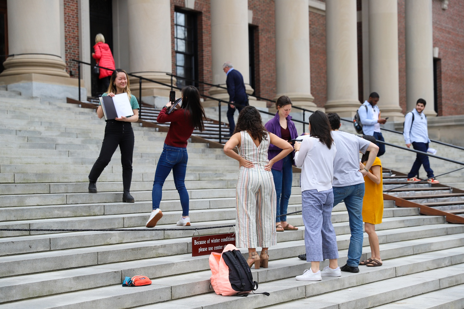 As many seniors were completing their theses during the month of March, students rushed to take the classic thesis picture on Widener Steps amid the chaos of vacating campus due to the novel coronavirus outbreak.