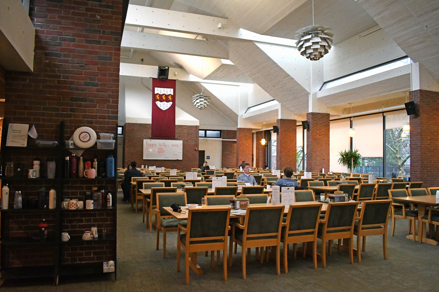 During the last few days on campus in March 2020, Mather Dining Hall was mostly empty, as house life declined while students experienced their final moments on campus.