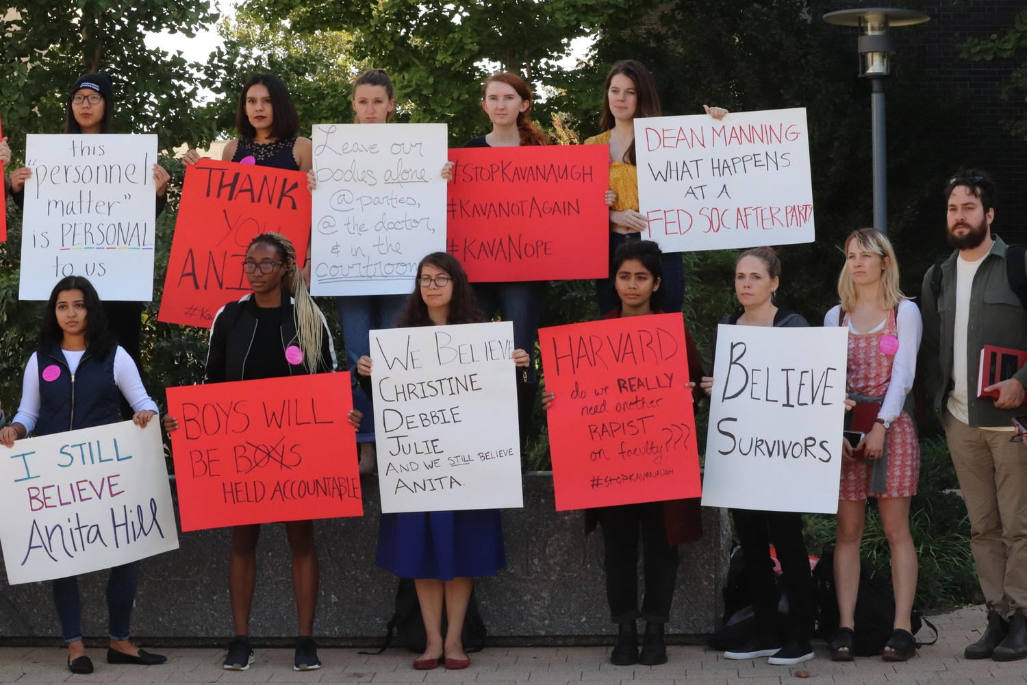 "In an anti-Kavanaugh demonstration outside of Pound Hall during a break in senators' questioning of Christine Ford, protestors flaunted posters reading ""We Deserve Better"" and ""I Still Believe Anita Hill"" to protest Kavanaugh's teaching position at Harvard Law School."