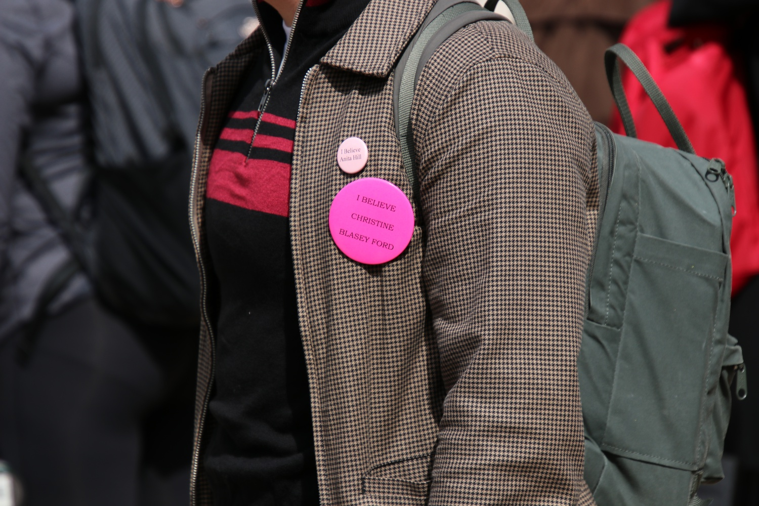 "Many protestors at the anti-Kavanaugh walkout donned pink ""I Believe Christine Blasey Ford"" buttons to demonstrate their support for Ford and Ramirez and to protest Kavanaugh's confirmation for the U.S. Supreme Court."