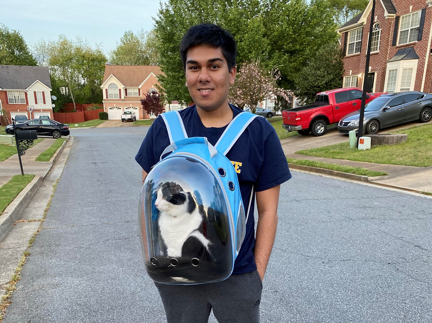 Tauheed Z. Islam '21 takes his cat for a walk near his home outside Atlanta, Ga.