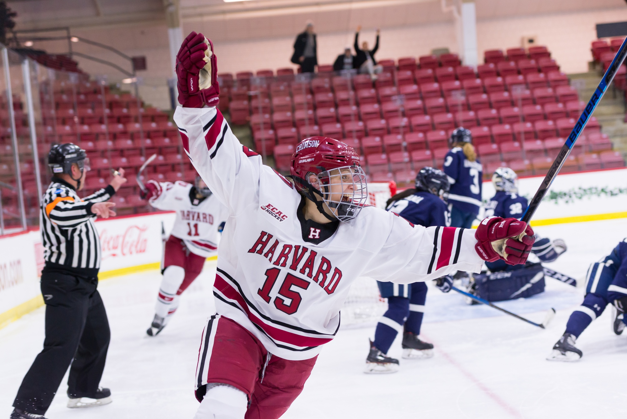 Junior forward Becca Gilmore throws her hands up in celebration after clinching the marathon, season-deciding contest with Yale in 3OT.