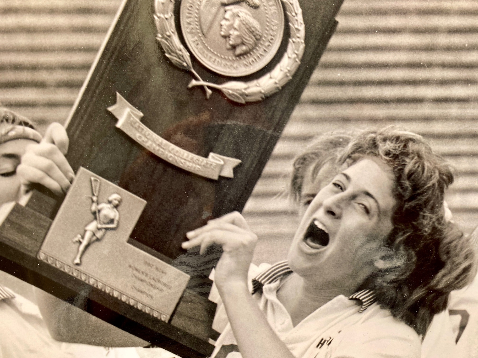 Julie Clifford Smail '90 holds the national championship trophy. Before the NCAA semifinal game, she took her organic chemistry exam in a hotel room and is now a doctor.