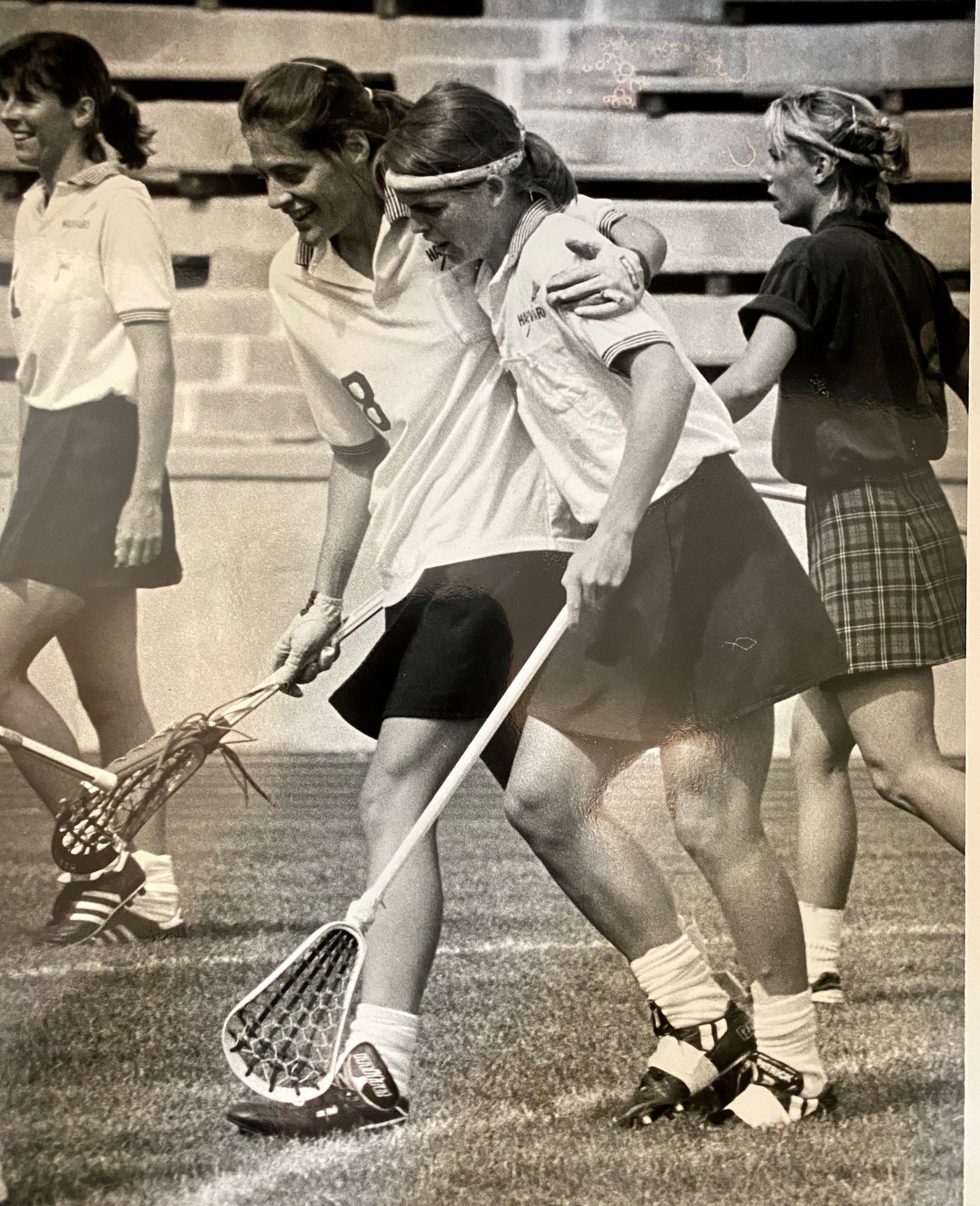 Lynn Frangione '90 and Char Joslin '90 embrace after a Harvard goal in the NCAA final against Maryland.