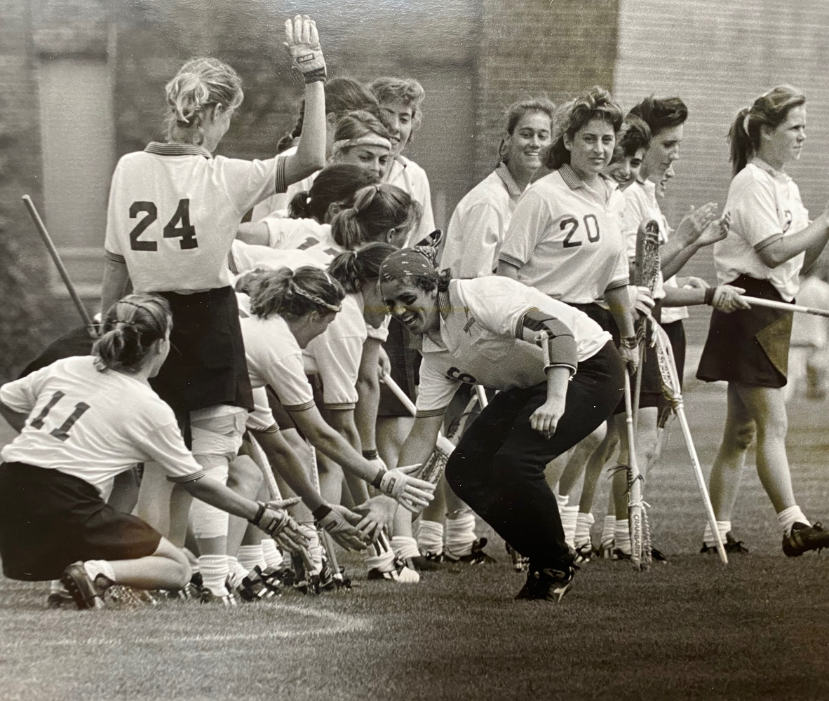 Goalkeeper Sarah Leary '92 high-fives her team during introductions before the NCAA title game.