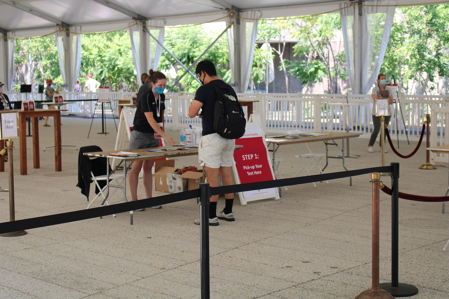 A student picks up a COVID-19 test in the Science Center tent.