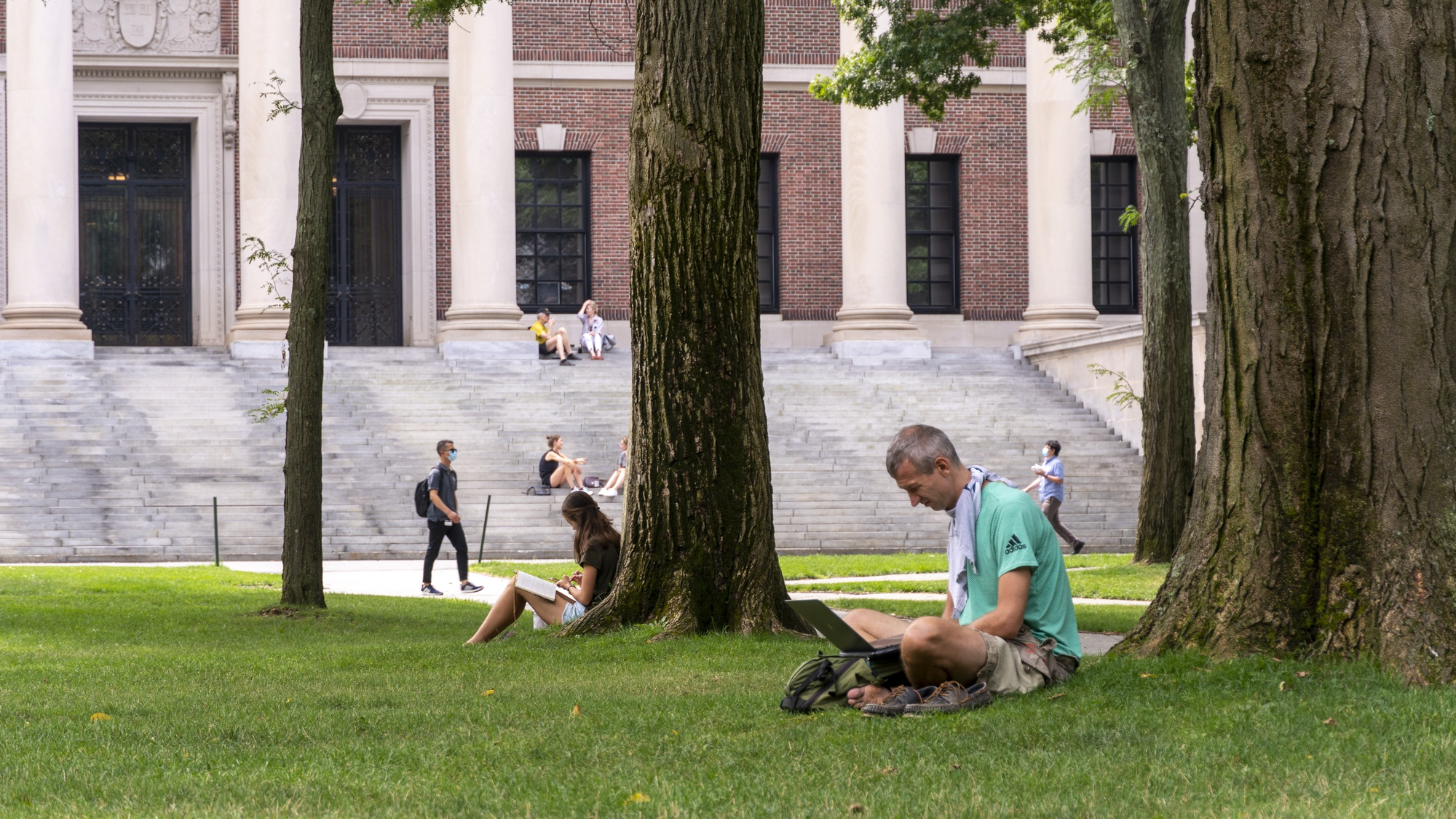 Tourists enjoy a socially-distant afternoon in the Yard.