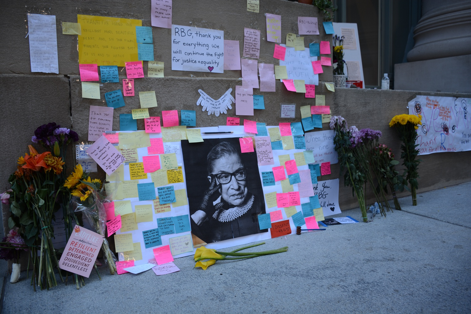 A memorial to Supreme Court Justice Ruth Bader Ginsburg, a Harvard Law School alumna, sprung up at the Law School this week after Ginsburg's death at the age of 87 Friday.