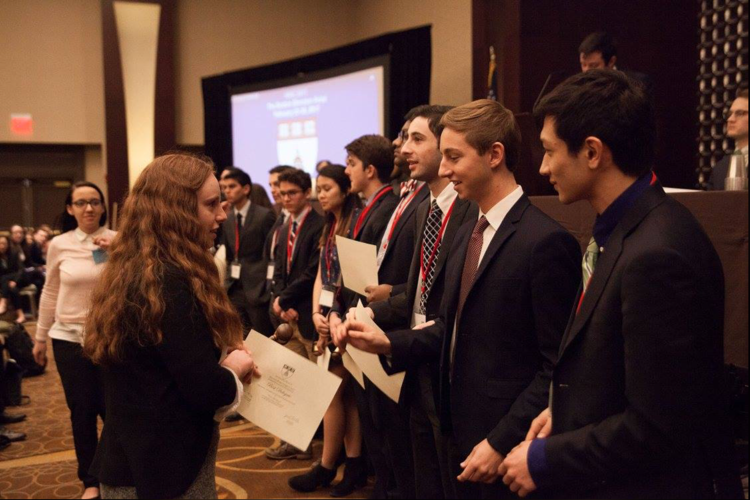 Members of Harvard Model Congress lead an awards ceremony.