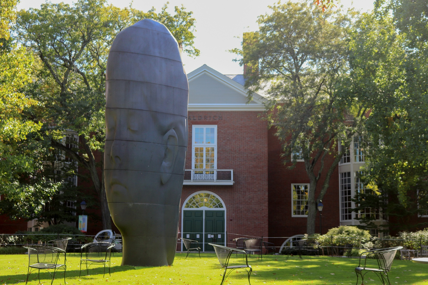 A contemporary art installation sits amid outdoor seating for students on the Business School's Aldrich Lawn.