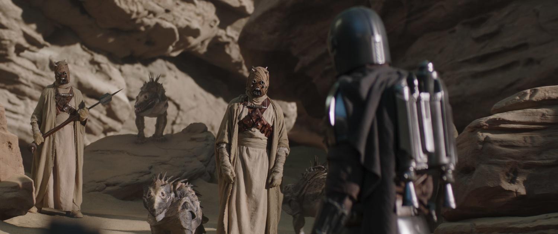 Tusken Raiders and The Mandalorian (Pedro Pascal) in 'The Mandalorian.'