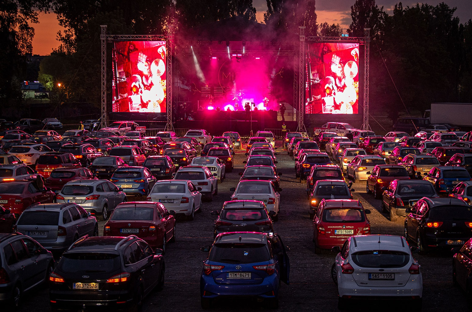 A photo of a drive-in concert.