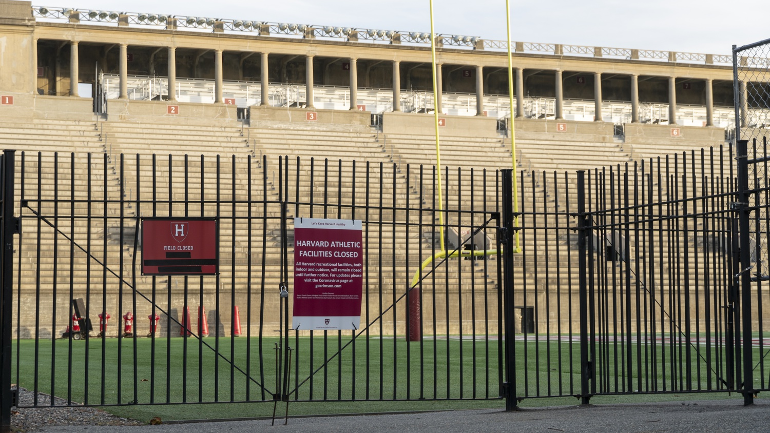 Signs posted outside Harvard Stadium announce that all recreational facilities are closed due to the COVID-19 pandemic.