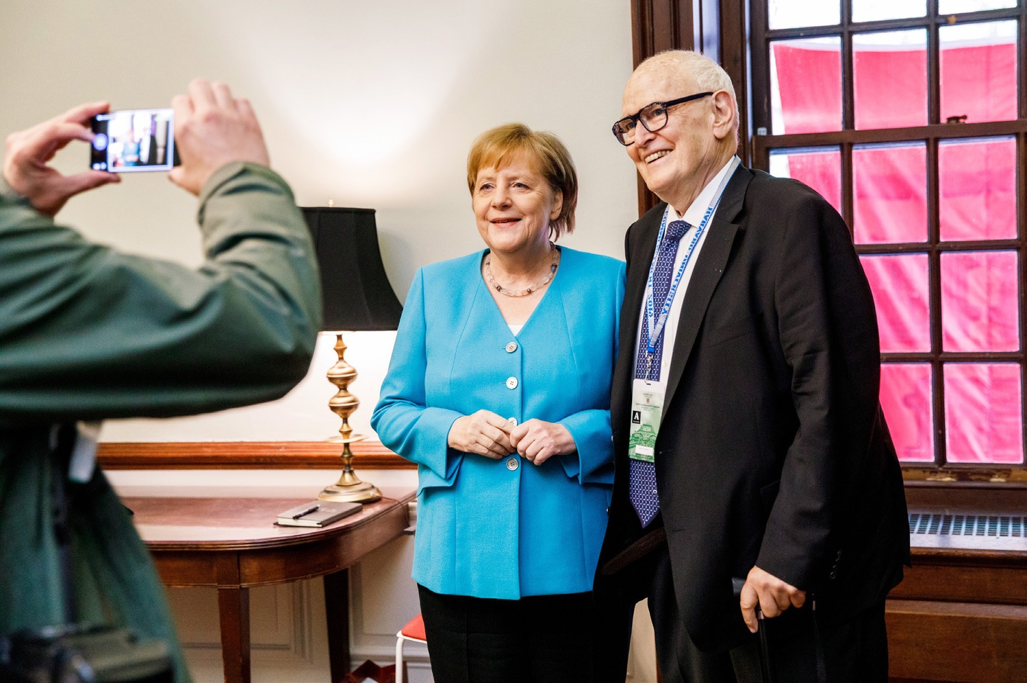 Guido Goldman and German Chancellor Angela Merkel speak at a luncheon during Harvard's 2019 Commencement.