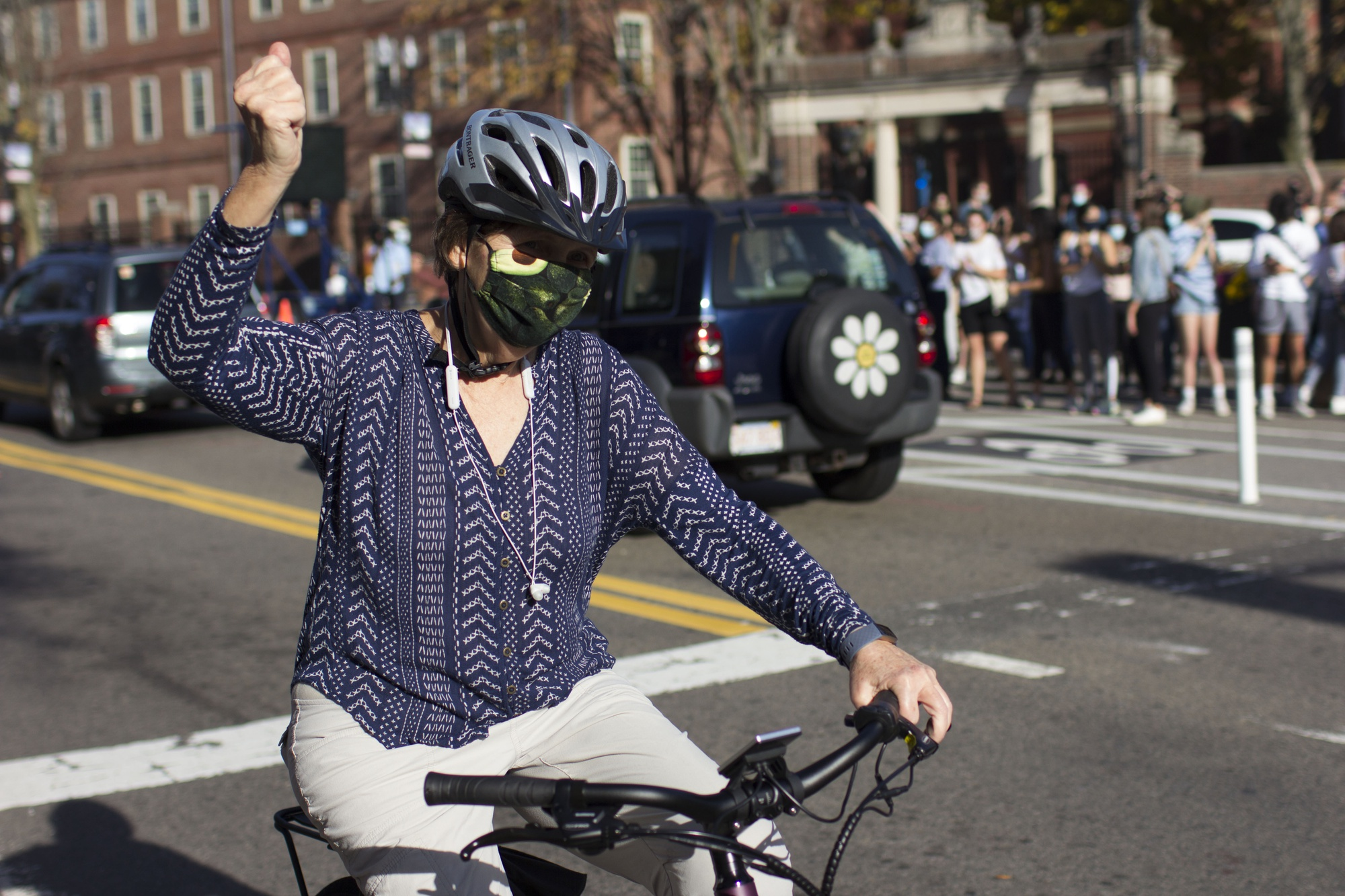 A cyclist raises a fist in celebration on Mass. Ave.