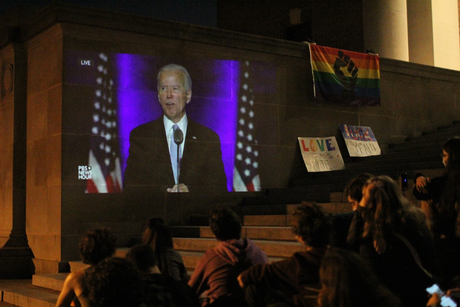 Harvard students living on campus watch former Vice President Joseph R. Biden Jr. deliver his acceptance speech from the steps of Widener Library