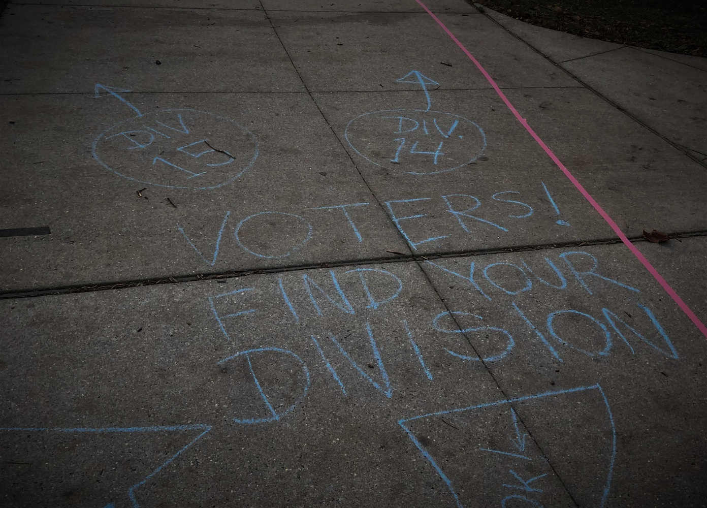 With chalk and tape, poll workers in Philadelphia attempt to guide voters to their appropriate division, all while maintaining safe social distance.