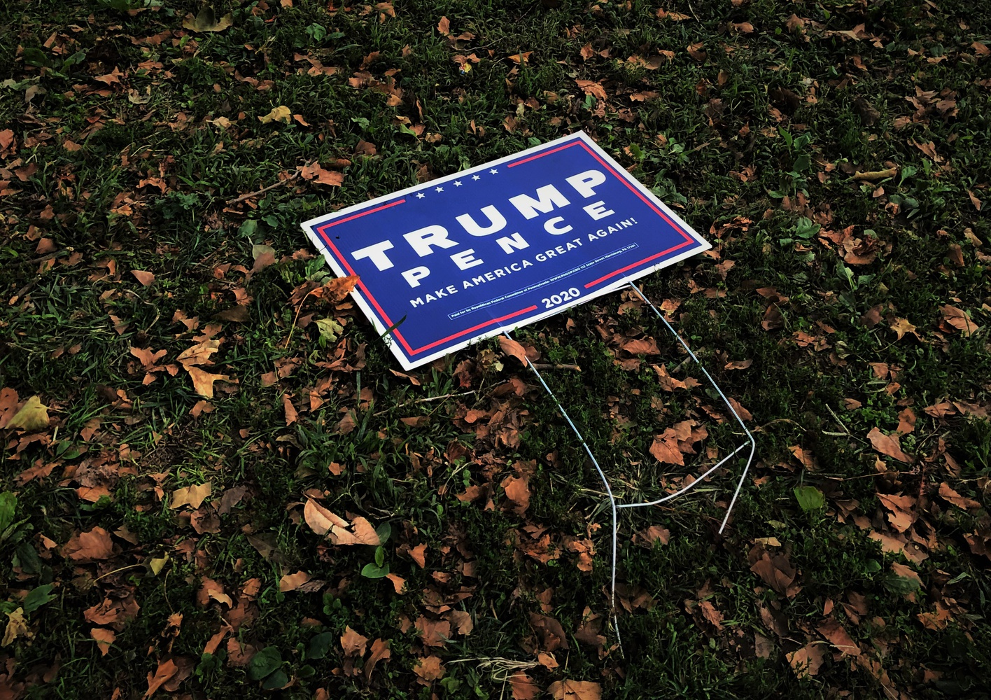 Outside a polling station, a Trump-Pence sign appears to have fallen over.