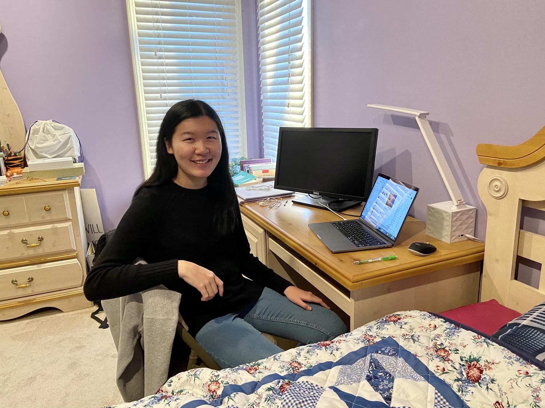 Li sits at the desk in her childhood bedroom in Overland Park, Kansas.